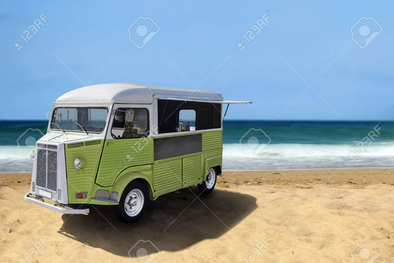 Green retro fast food truck on the beach, vertical template with copy space - 51246382