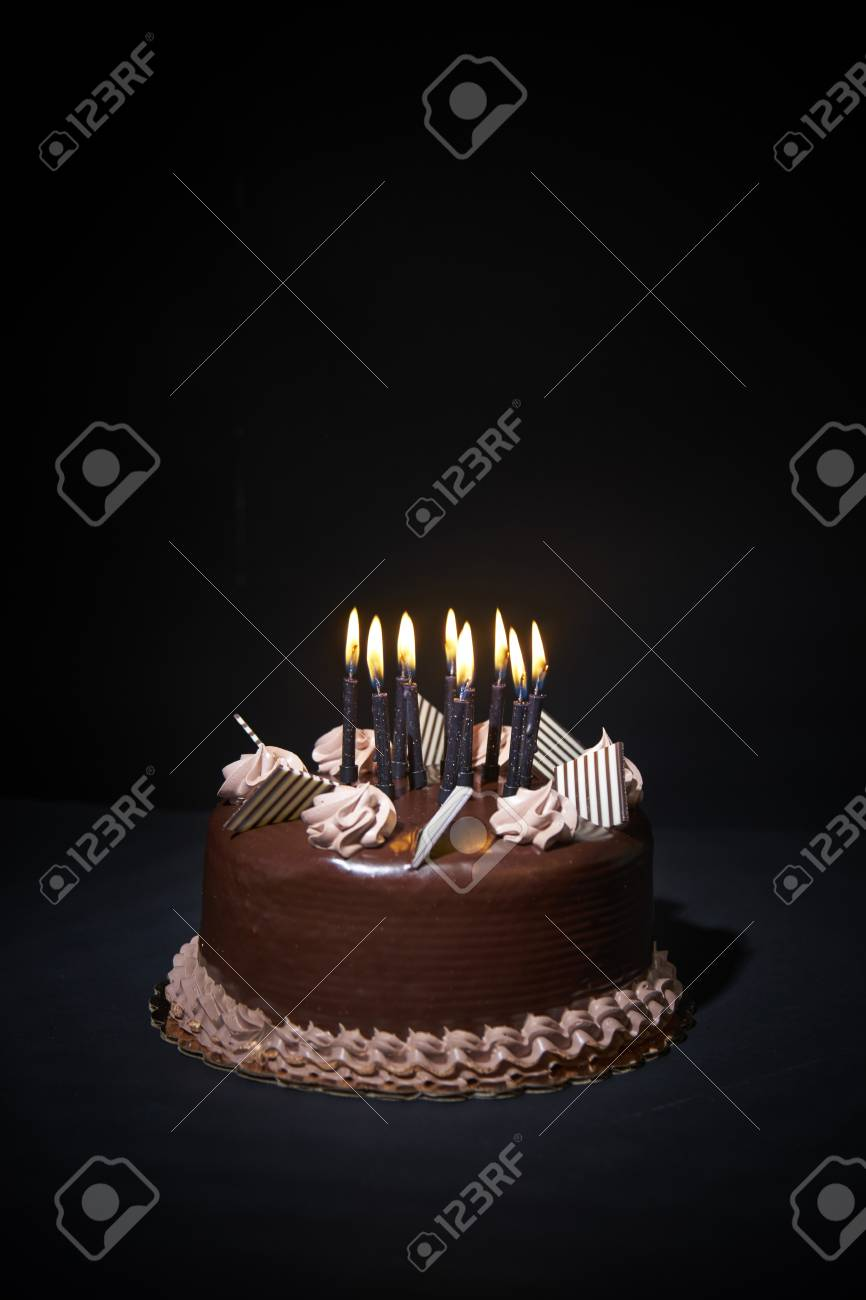 Fantastic Chockolate Birthday Cake With Candles On Black Background Closeup Personalised Birthday Cards Paralily Jamesorg