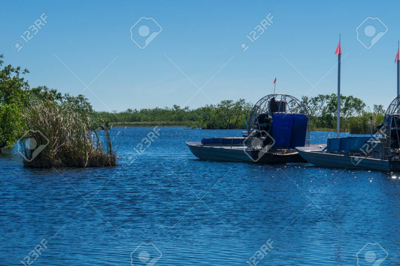USA, Florida, Two airboats with huge propellers in the water