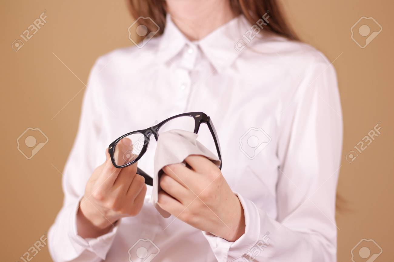 3e8afadcc0 Stock Photo - Women hand cleaning glasses lens with isolated background