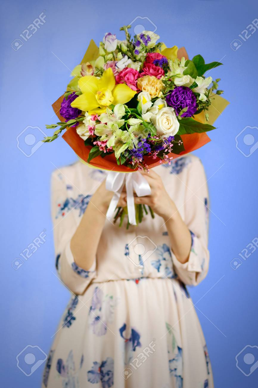 Beautiful Girl In Dress Holding A Bouquet Of Different Flowers