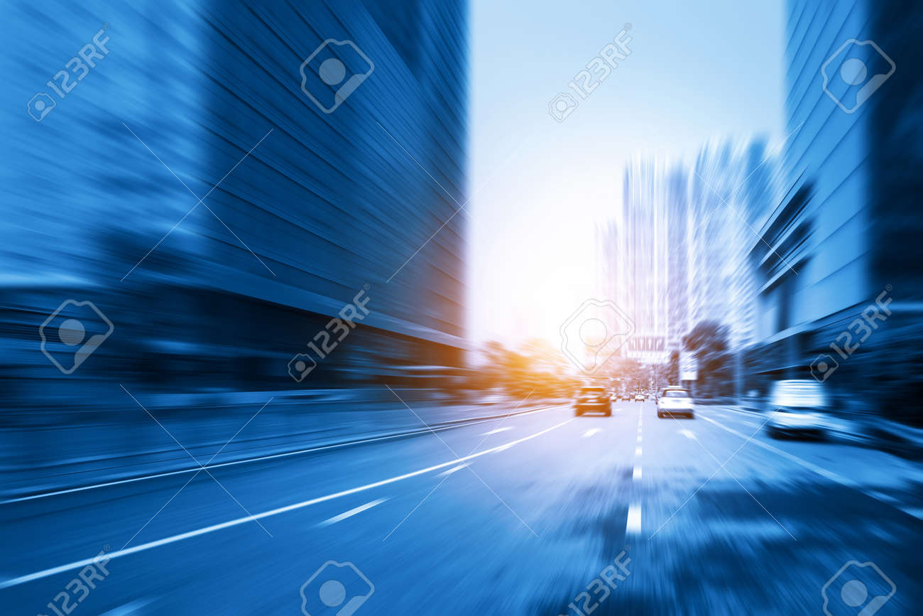 Motion blurred highway and skyscrapers in Shenzhen, China - 145384154