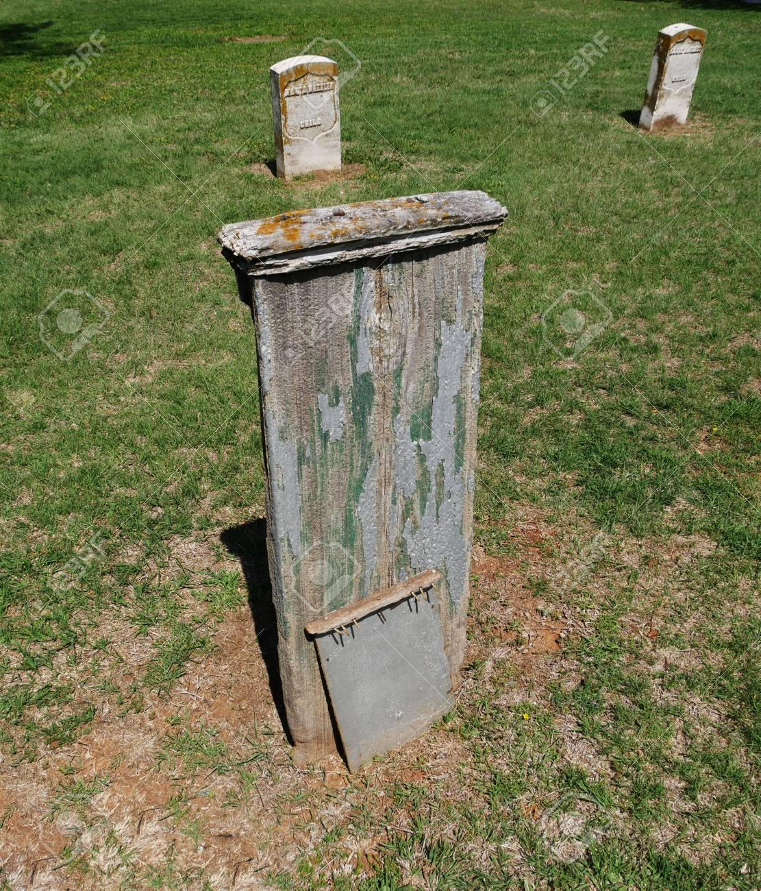 Old Wooden Grave Marker At A Cemetery