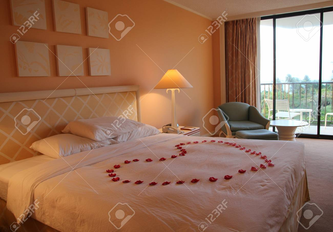 Rose Petals Shaped Into A Big Heart In The Middle Of A King Sized Stock Photo Picture And Royalty Free Image Image 123631934