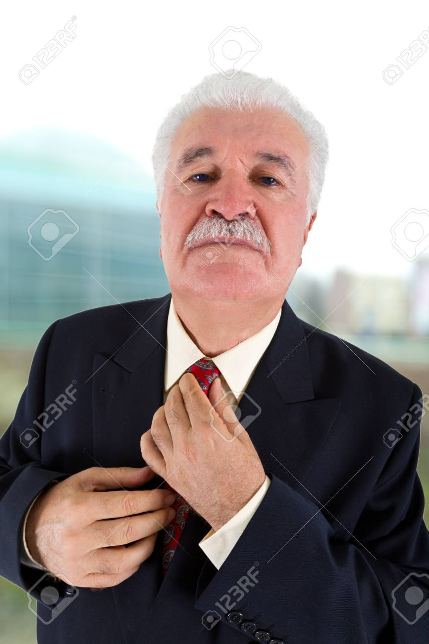 Experienced Businessman Adjusting His Tie Stock Photo - 11938642