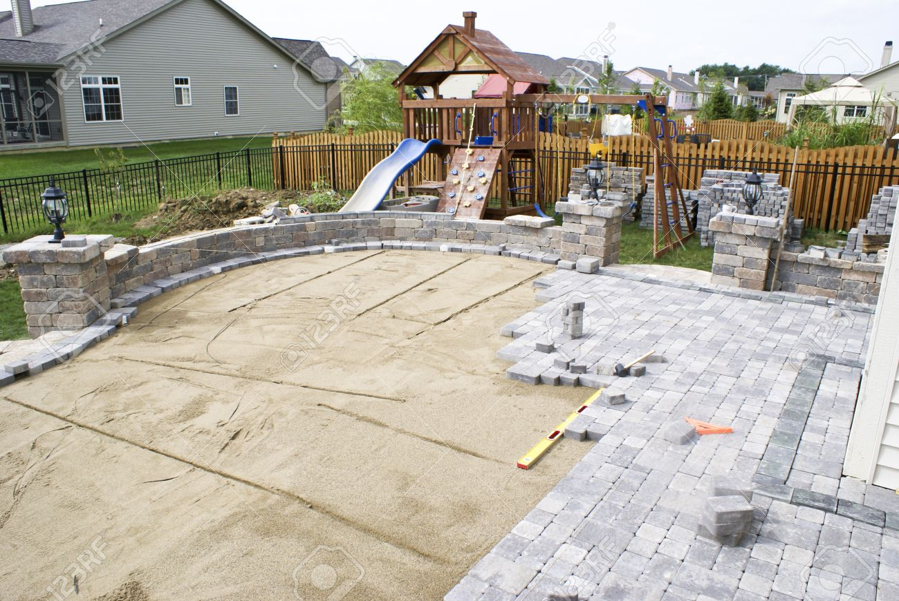 Paving Patio On To Levelled Sand. Baxkyard Project. Stock Photo   13096992