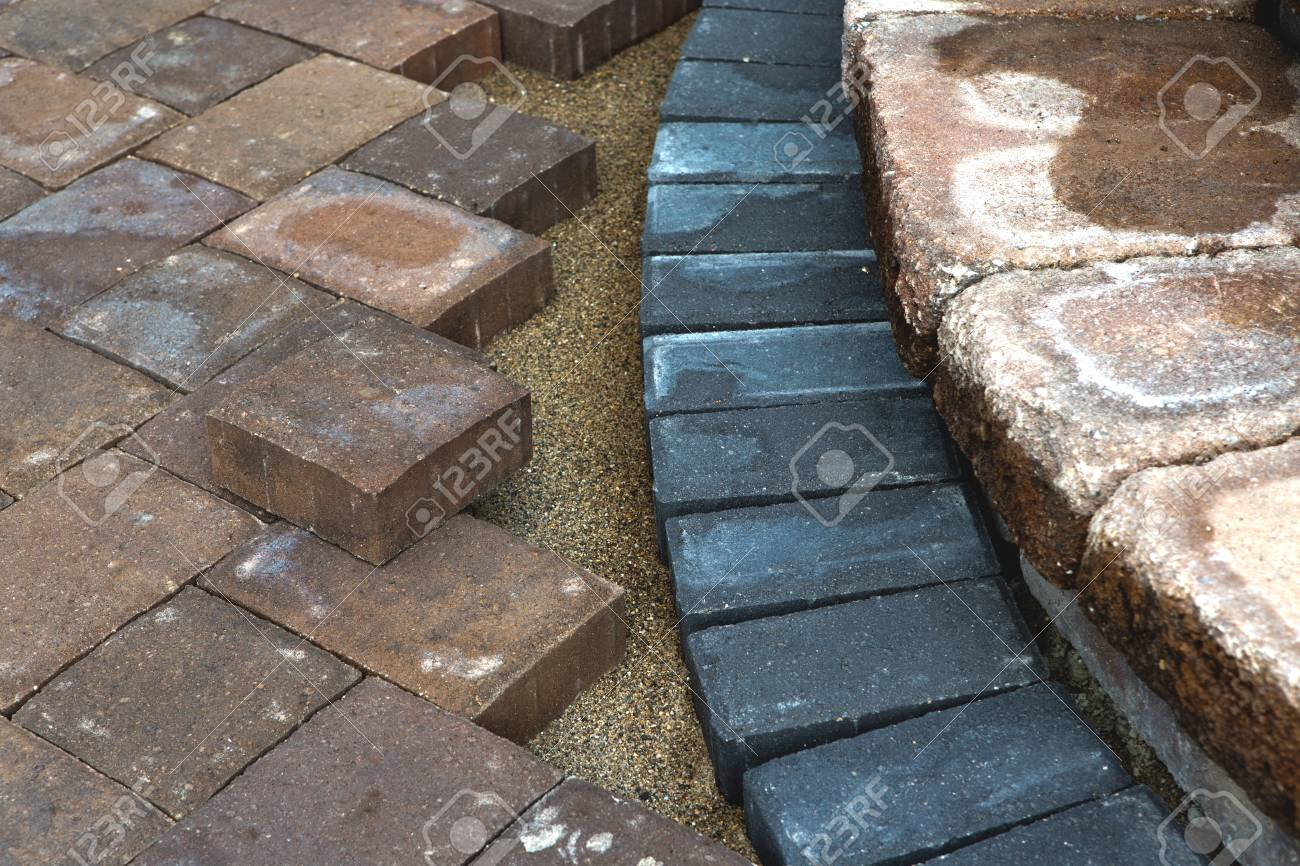 Paving around patio steps with diffrent color tumbled pavers