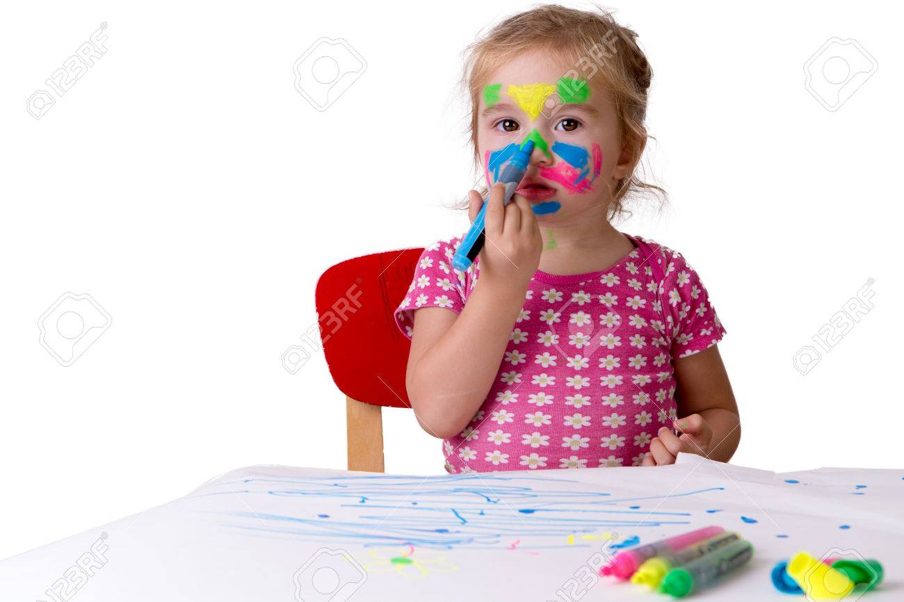 toddler girl coloring her own face with colorful markers hopefully they are not permanent stock