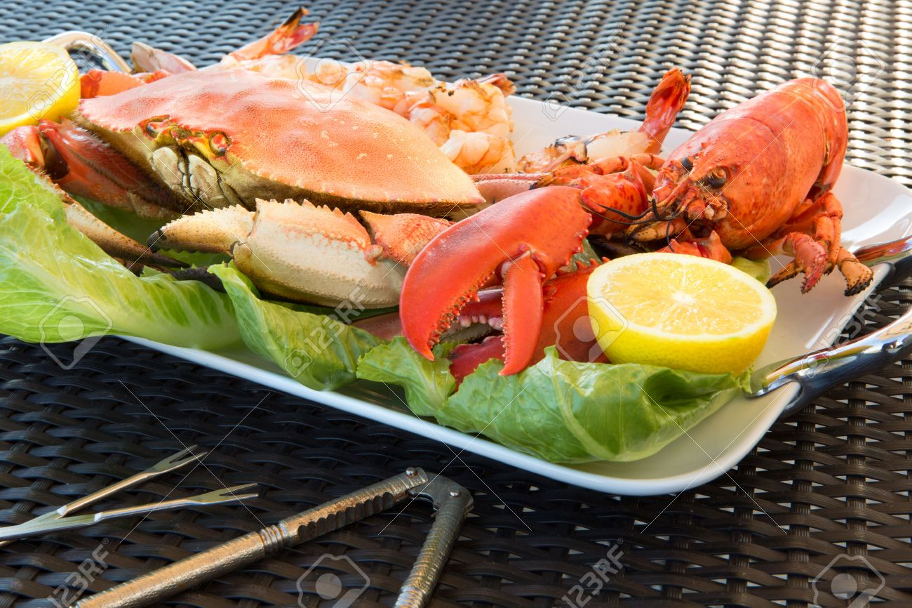 Red Lobster Dungenees Crab And Jumbo Shrimps On A Plate Along