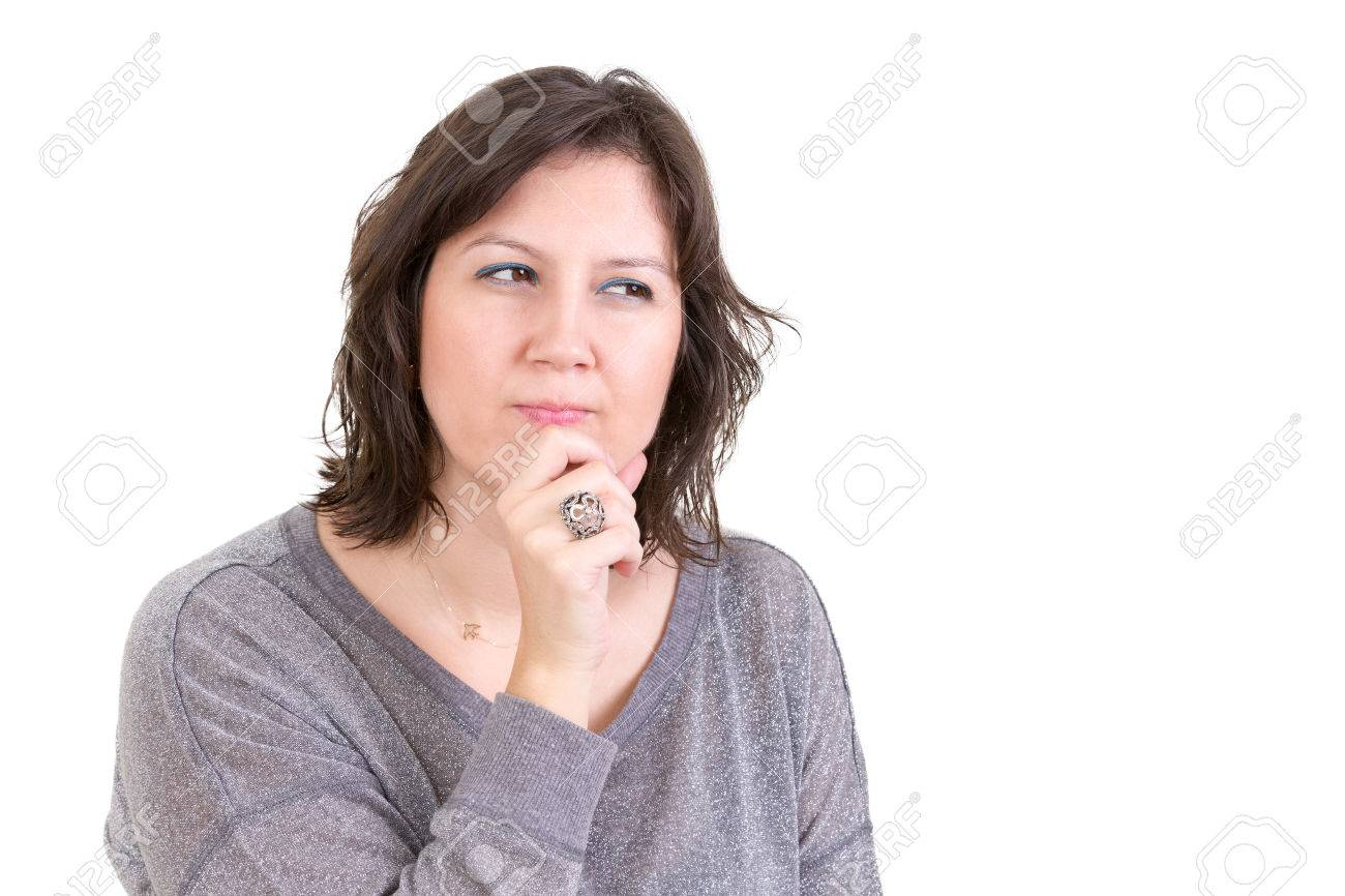 Woman with a calculating pensive look sitting with her hand to her chin as she plans and schemes for the future, isolated on white Stock Photo - 24435153
