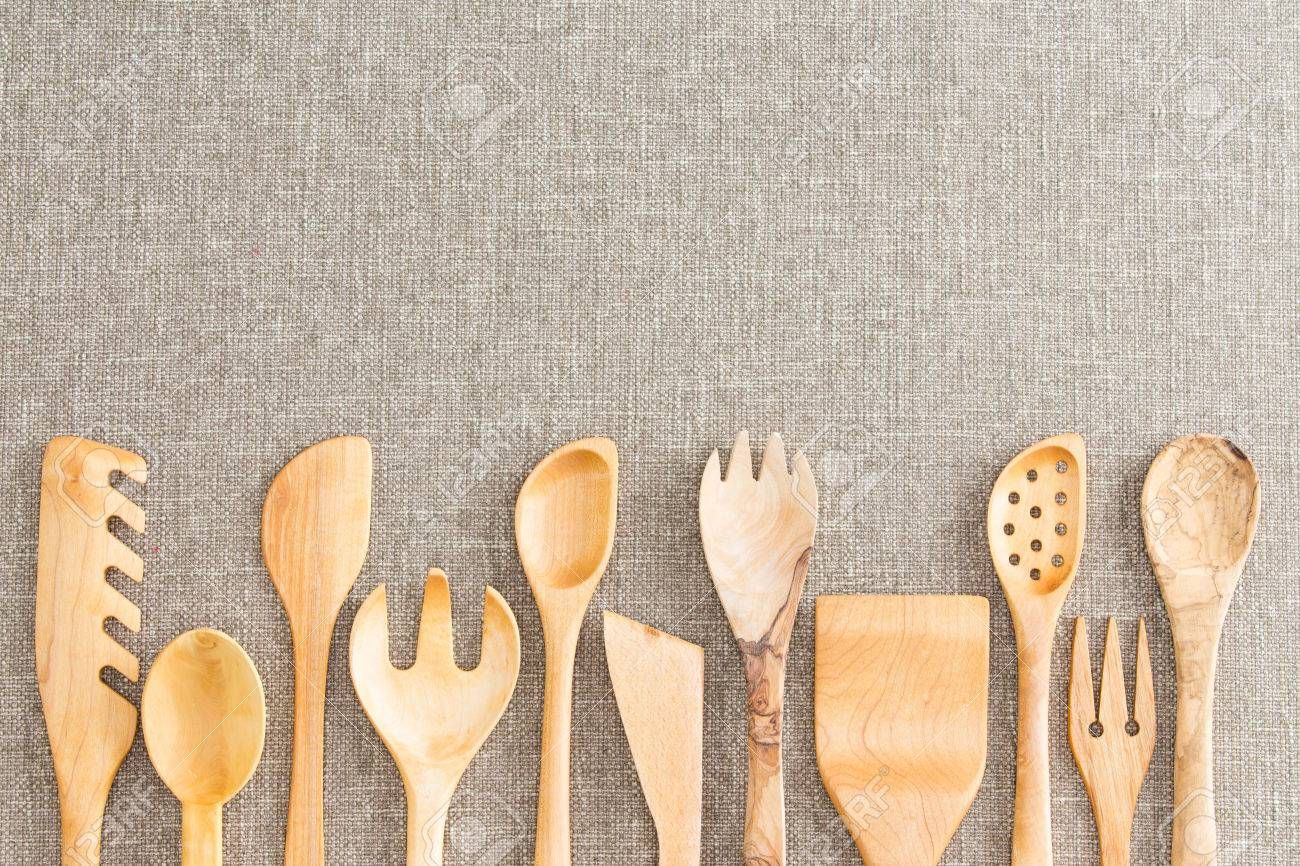 Border Of Wooden Kitchen Necessities With The Heads Of Assorted Utensils In  A Row Along The
