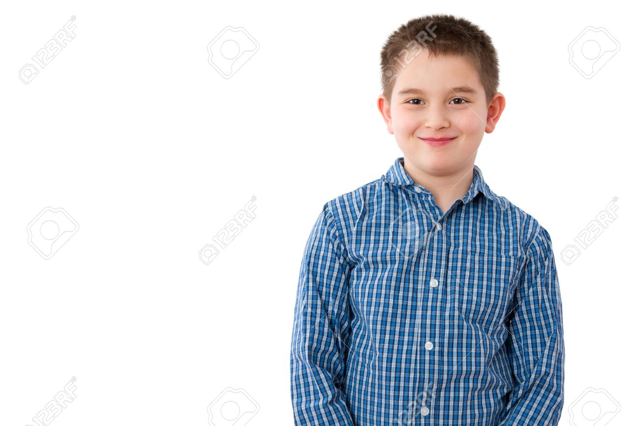 Portrait Of A Cute 10 Year Old Boy With A Mischievous Sweet Smile