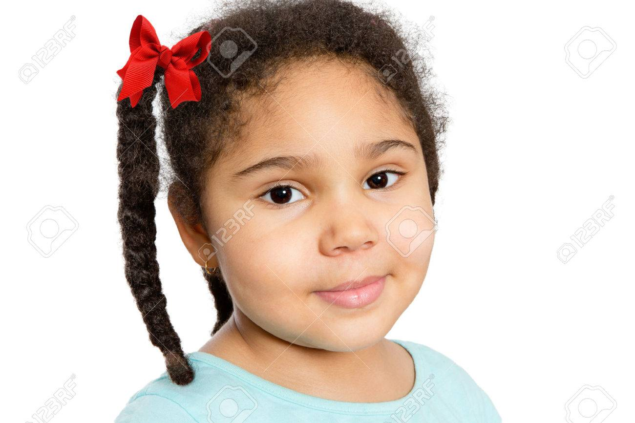 chubby preteens Close up Cute Young Girl with Braided Curly Hair Looking at You with Half  Smile,