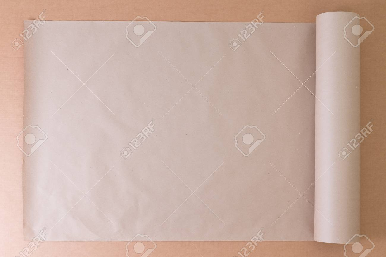 Opened roll of plain brown paper on cardboard for creative opened roll of plain brown paper on cardboard for creative artistic designs or craft work jeuxipadfo Choice Image