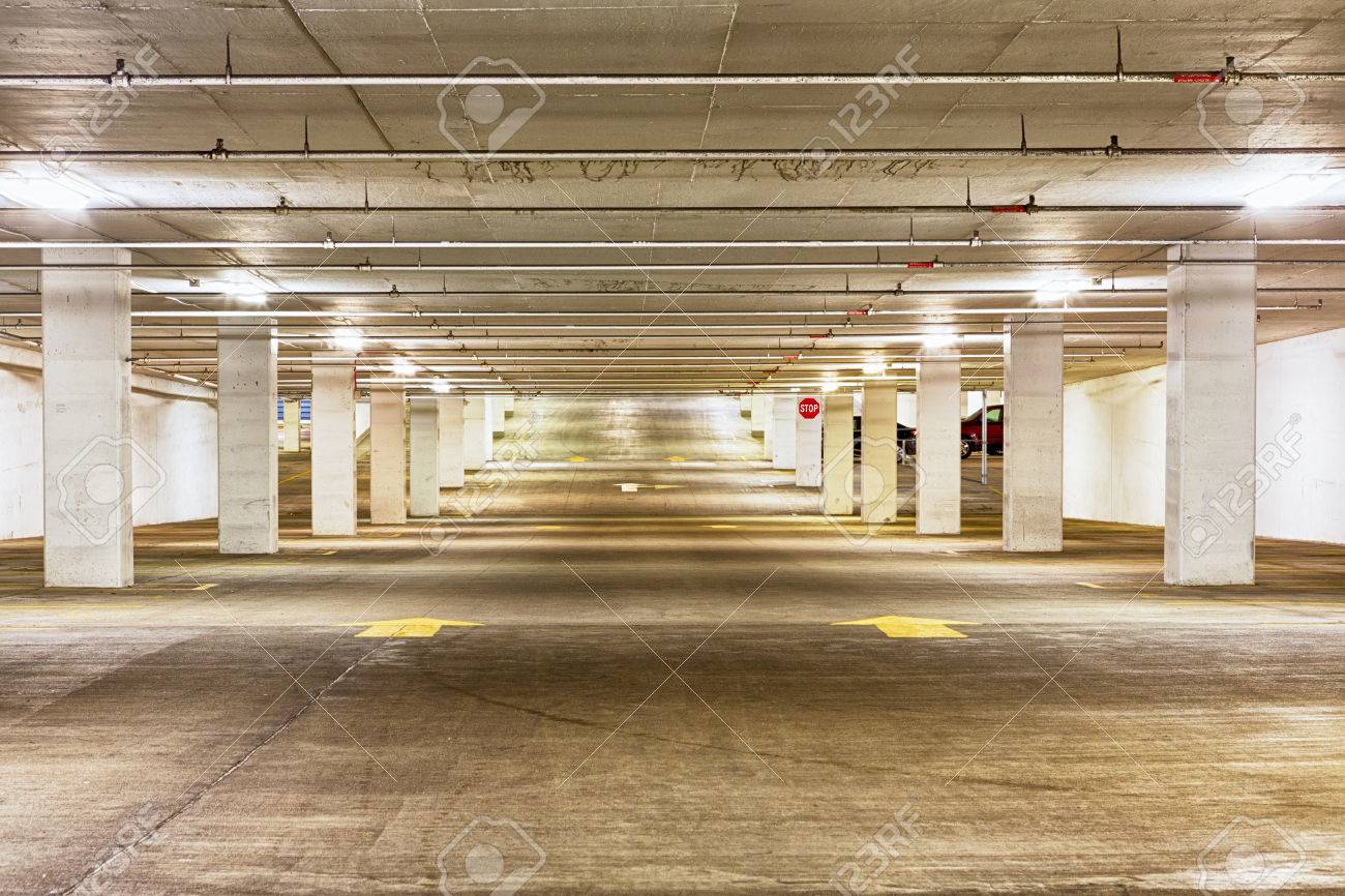 View looking down the length of an empty undercover parking garage