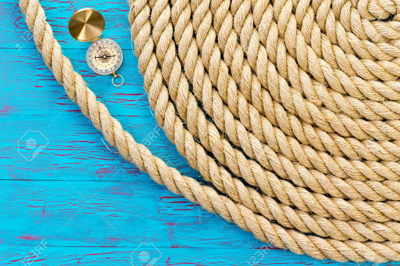 Neatly wound and coiled natural fiber rope with an open magnetic