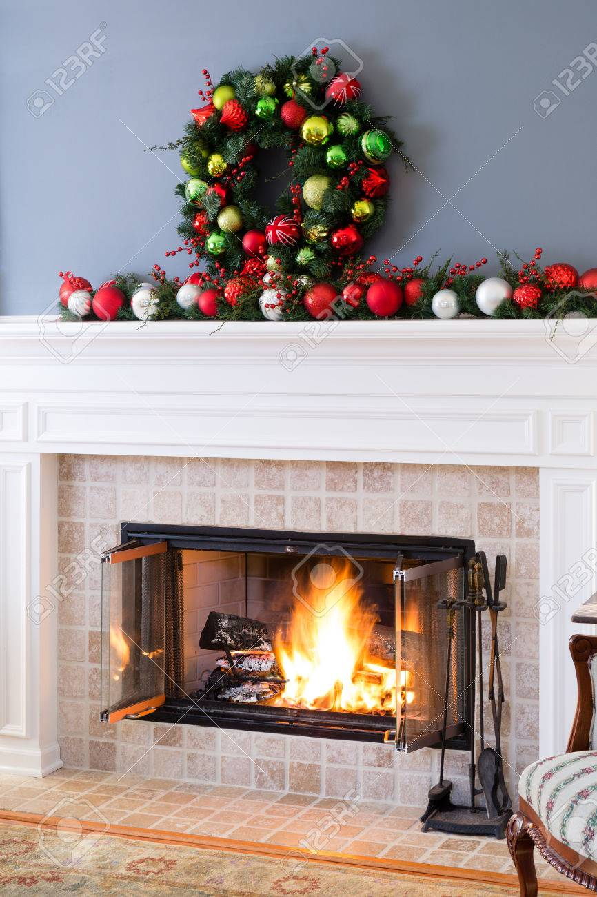 Christmas Hearth.Christmas Fireplace With Colorful Decorations And And A Traditional