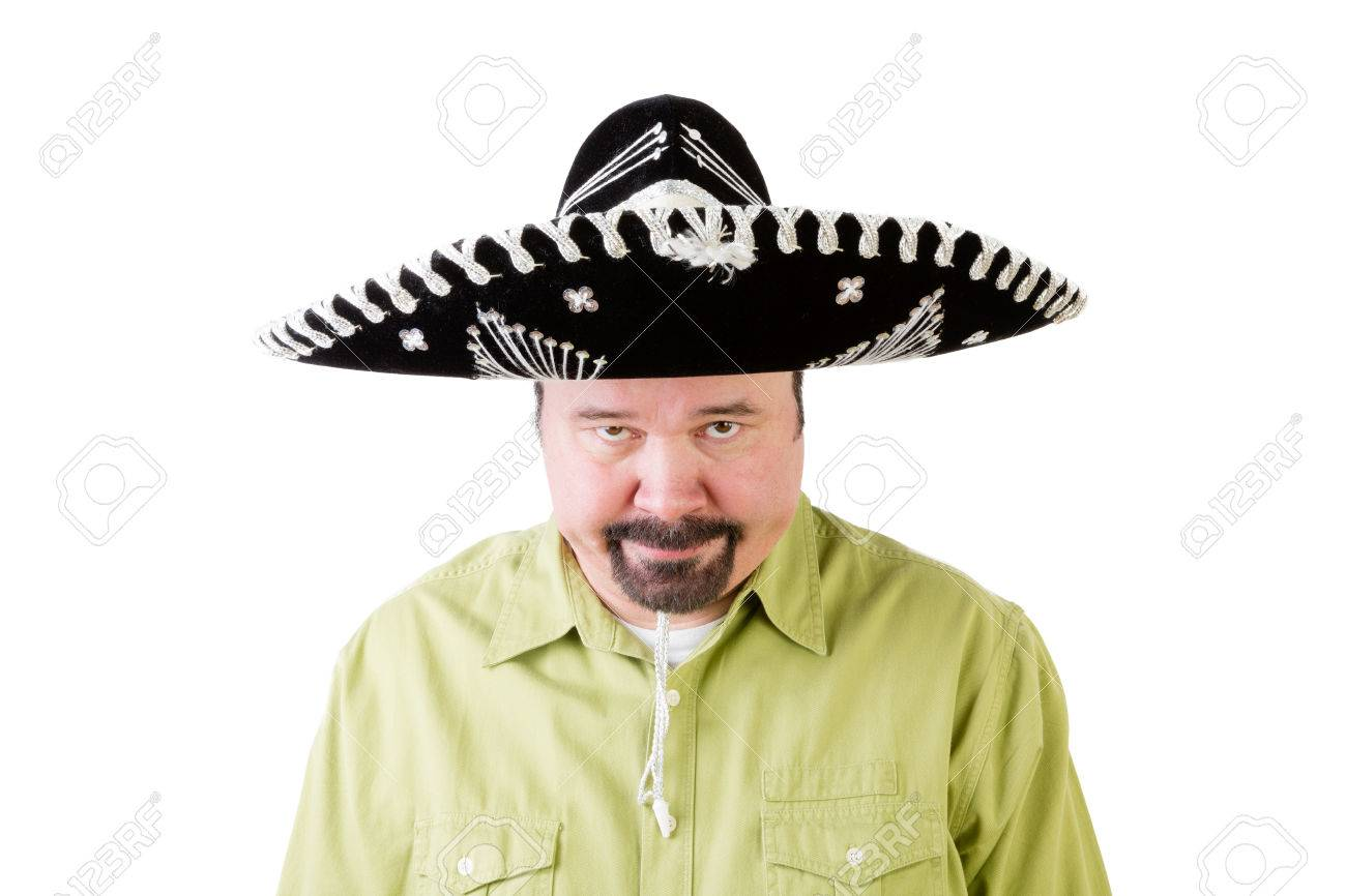 Grumpy middle aged man in Mexico sombrero hat looking downwards on white  Stock Photo - 67523600 ad65588f977