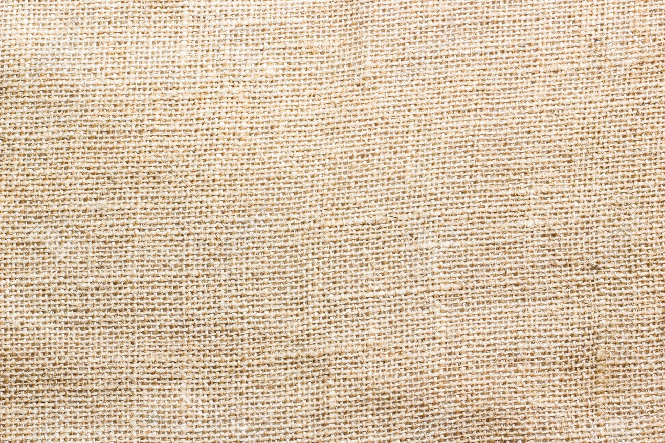 Natural Fabrics Sackcloth Woven Texture Background In Yellow Beige Cream As A Light Brown Vintage