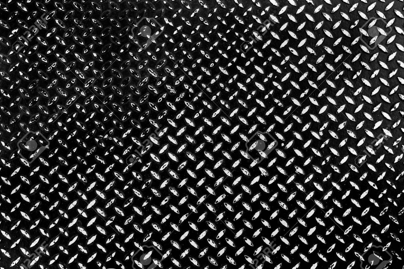 Metal floor plate texture background wite diamond pattern of