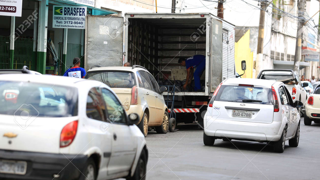 salvador, bahia / brazil - july 20, 2016: Cargo delivery truck is seen unloading orders in downtown Salvador. - 166163731