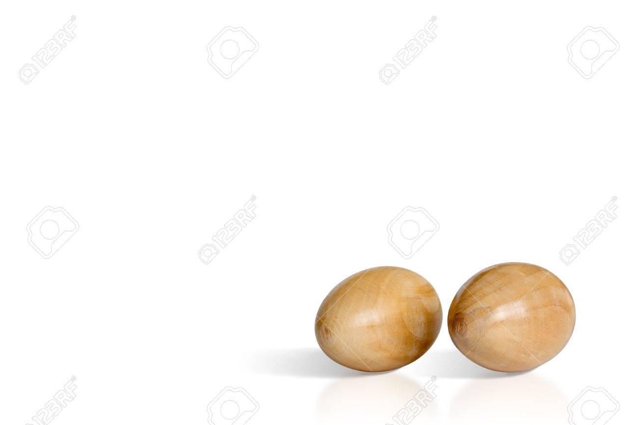 2 wooden Easter eggs made on lathe machine isolated on white Stock Photo - 9319078