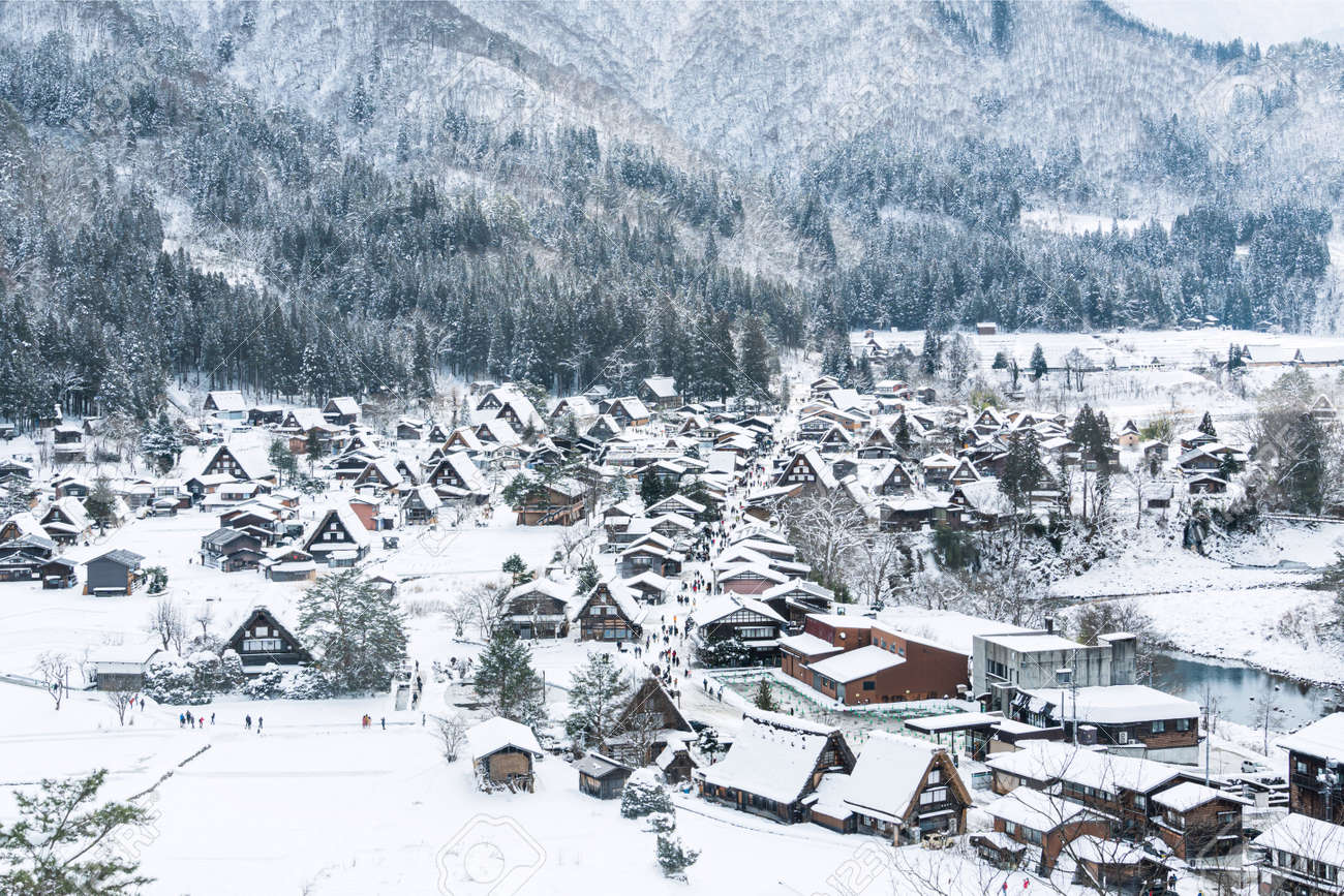 Top view of Shirakawa-go villages in snowfall day, Gifu prefecture Japan, Village hill view point in snowing fall winter - 169890751