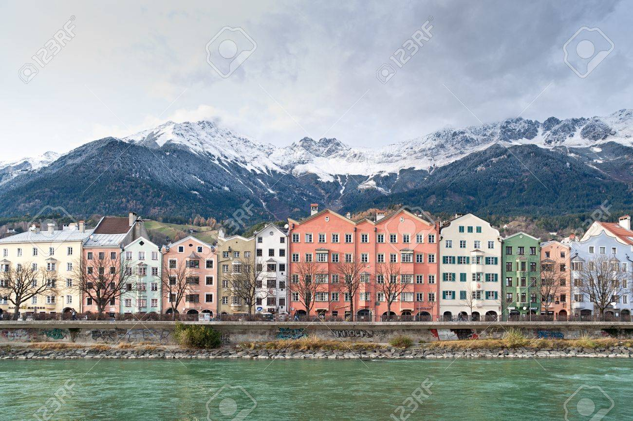 row of houses in innsbruck in the background the austrian alps