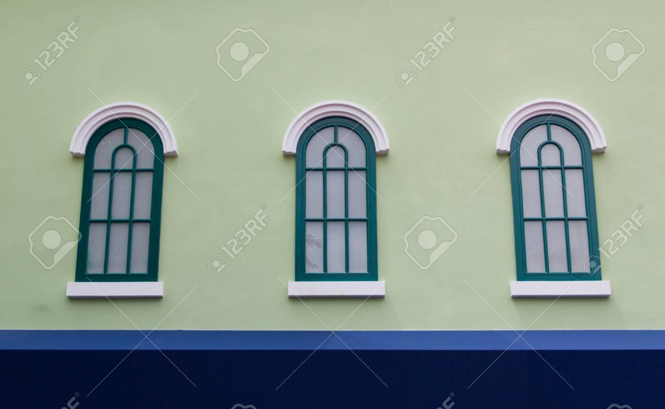 Window on the green wall Stock Photo - 22255586