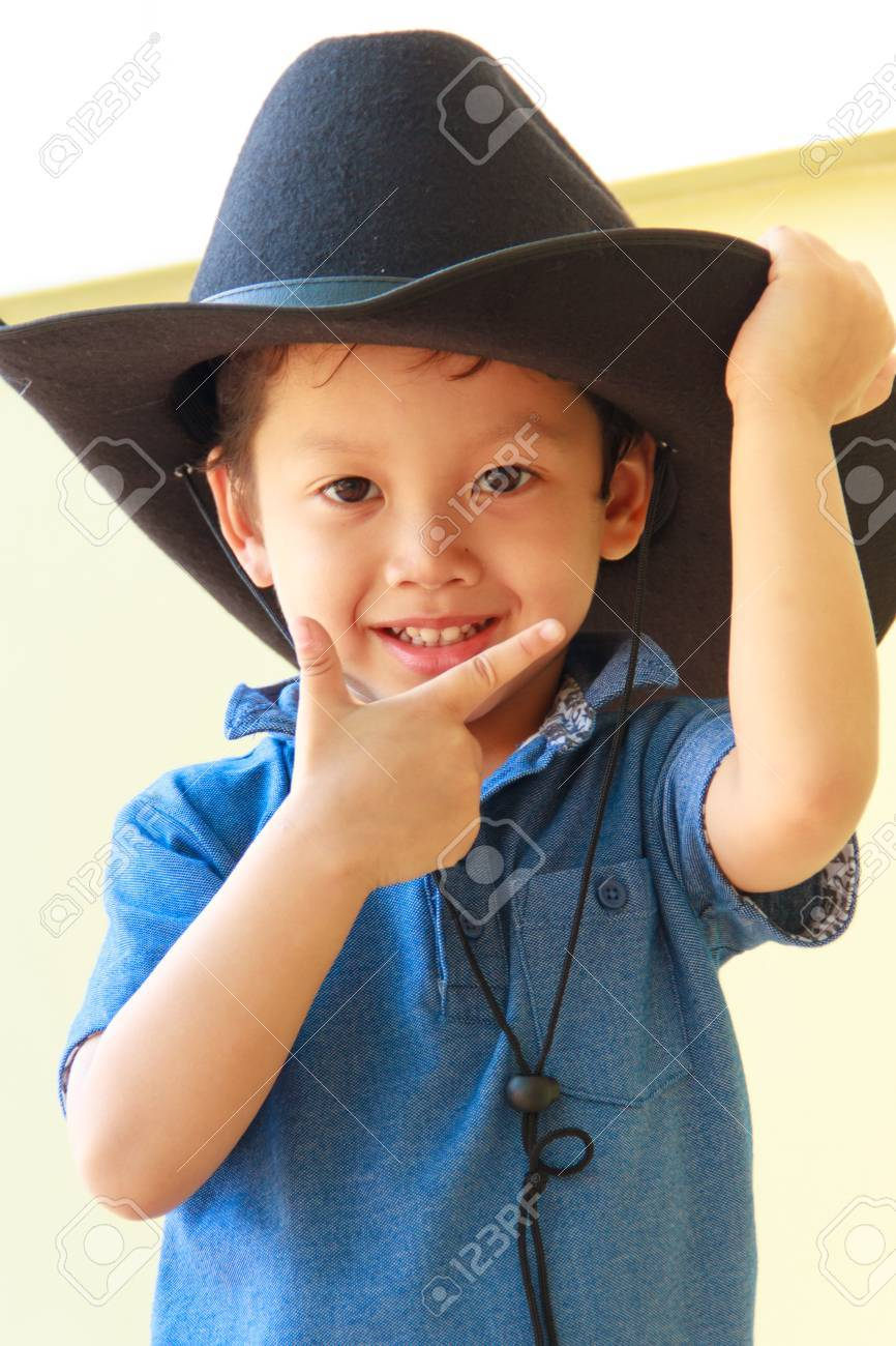 Little boy wearing a black cowboy hat Stock Photo - 36305122 68e08e53aaf