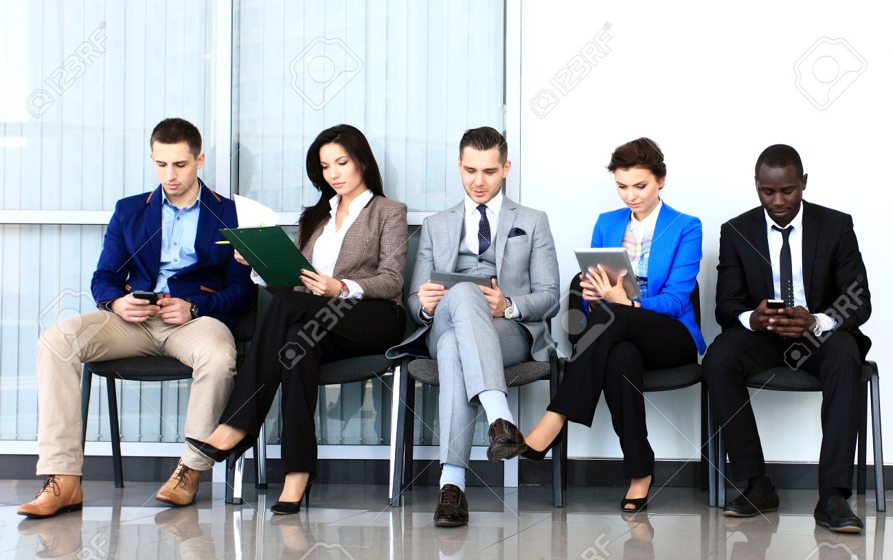 business people waiting for job interview five candidates business people waiting for job interview five candidates competing for one position stock photo 30447446