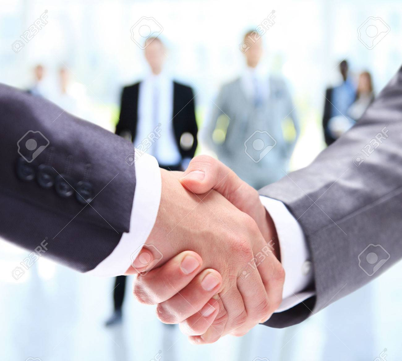 Business people handshake greeting deal at work photo free download - Closeup Of A Business Handshake Business People Shaking Hands Finishing Up A Meeting Stock