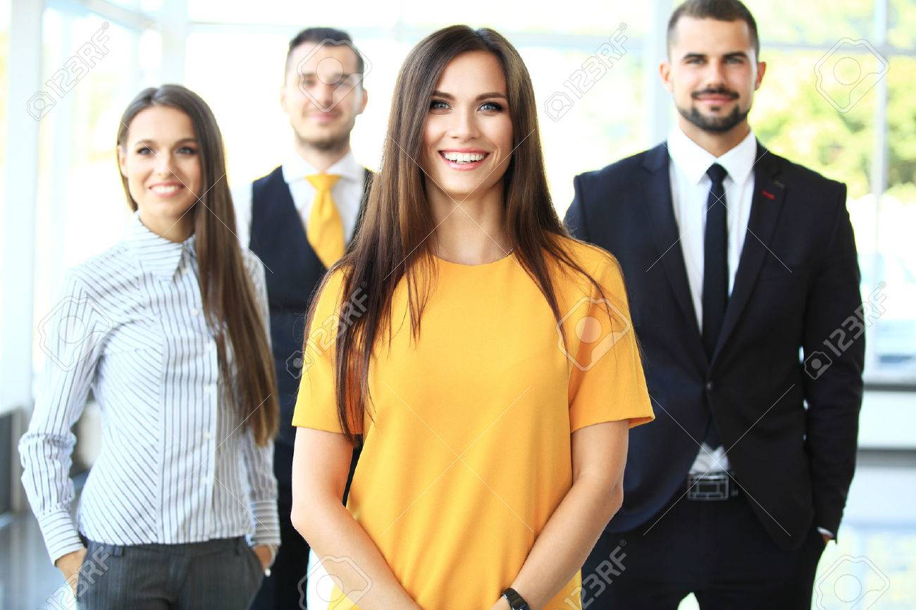Successful business team smiling at the office - 48074233