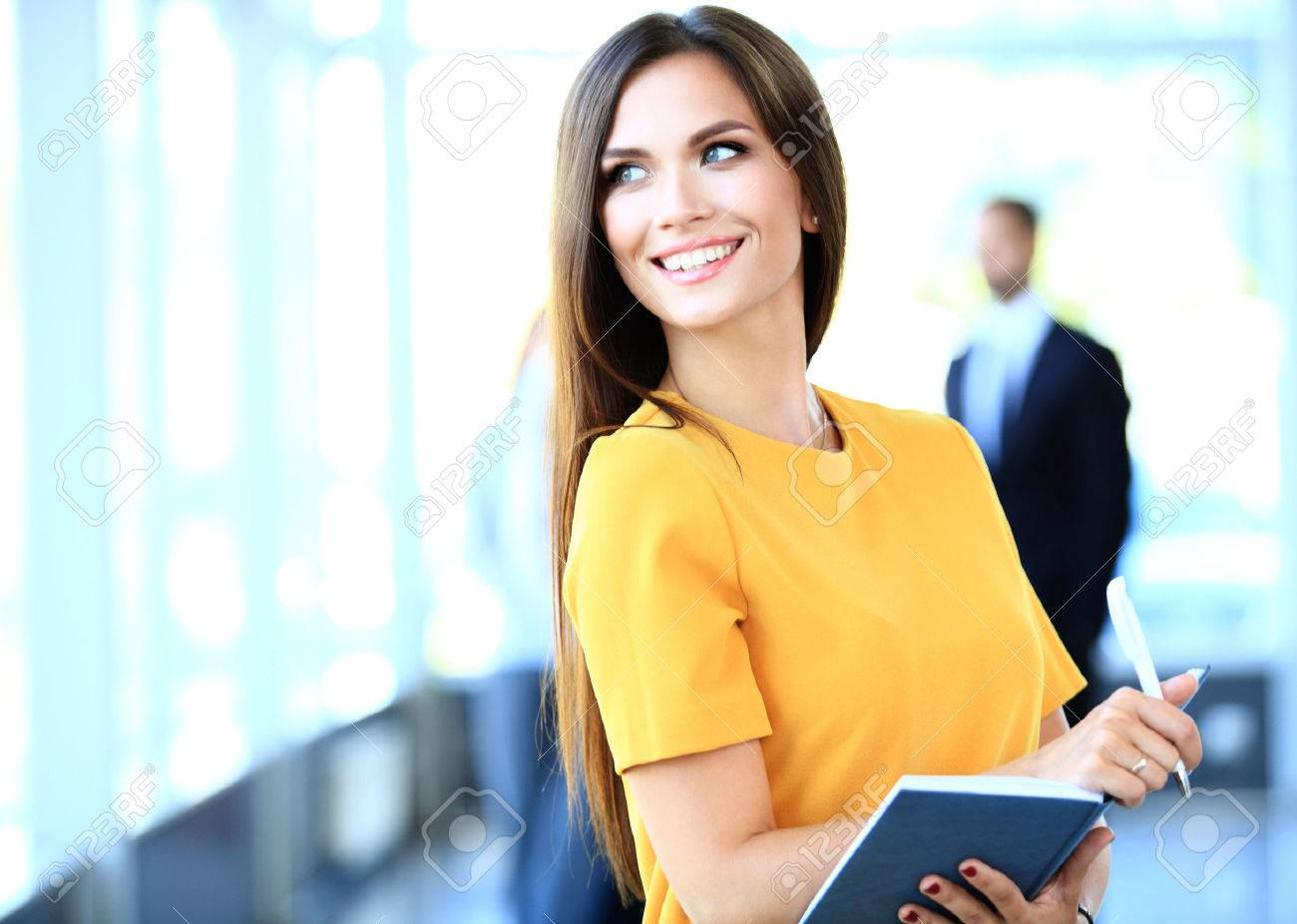 business woman with her staff, people group in background at modern bright office indoors - 48284611