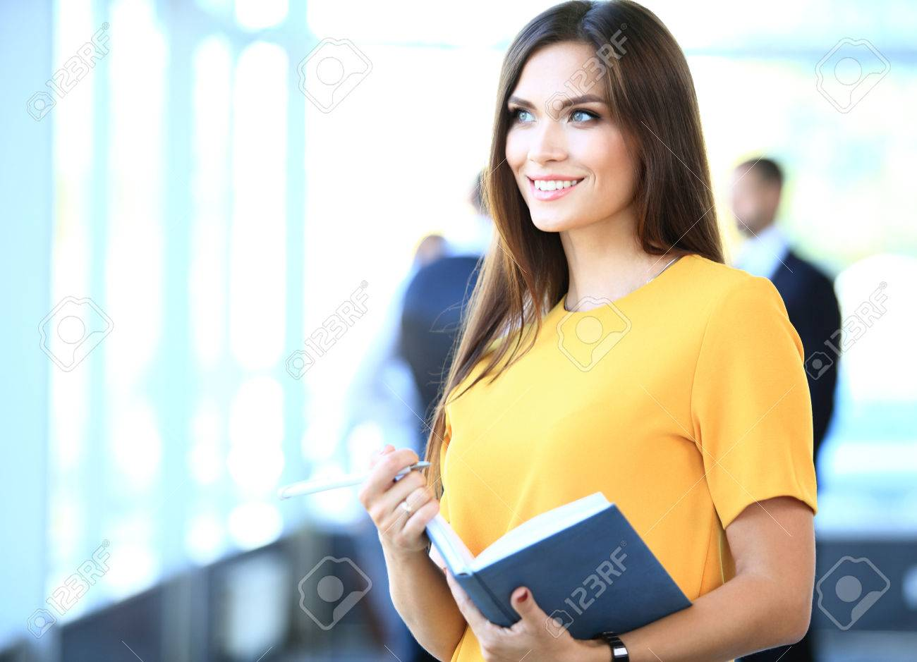 business woman with her staff, people group in background at modern bright office indoors - 48284607