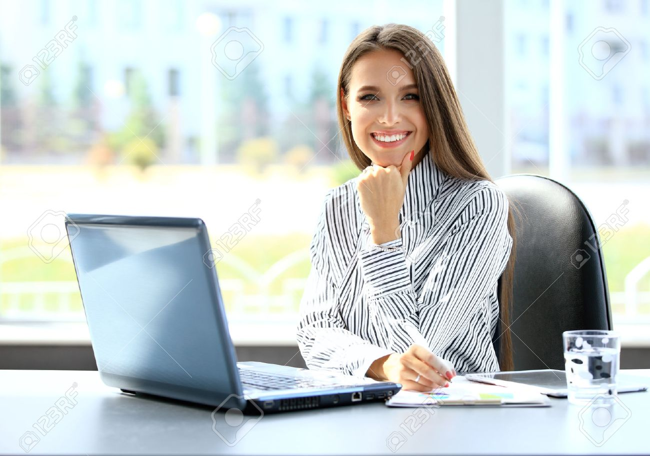 Business woman working on laptop computer at office - 50162937