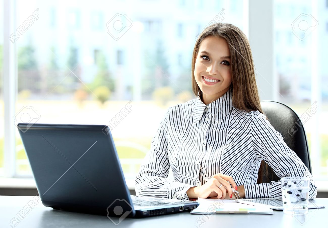 Business woman working on laptop computer at office - 50162938