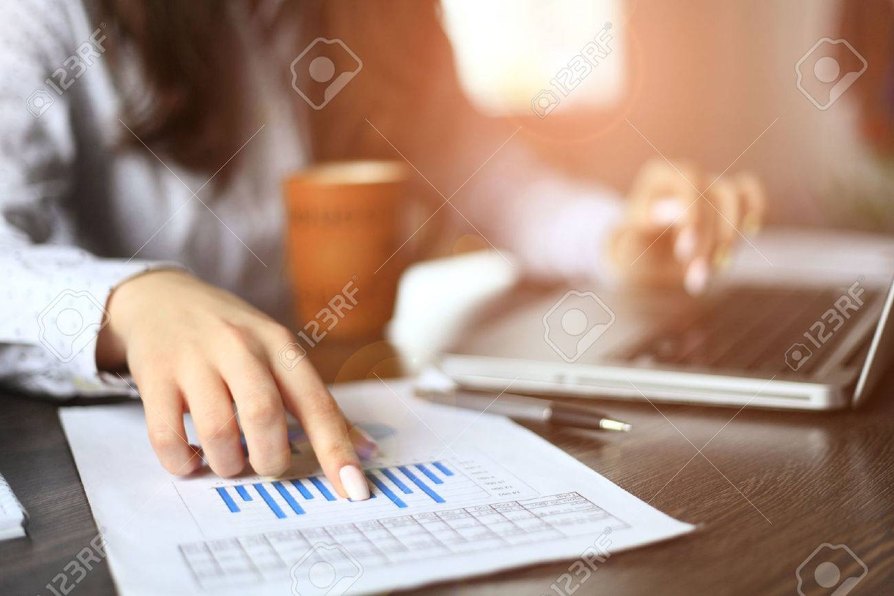 Hands of financial manager taking notes when working - 51367935