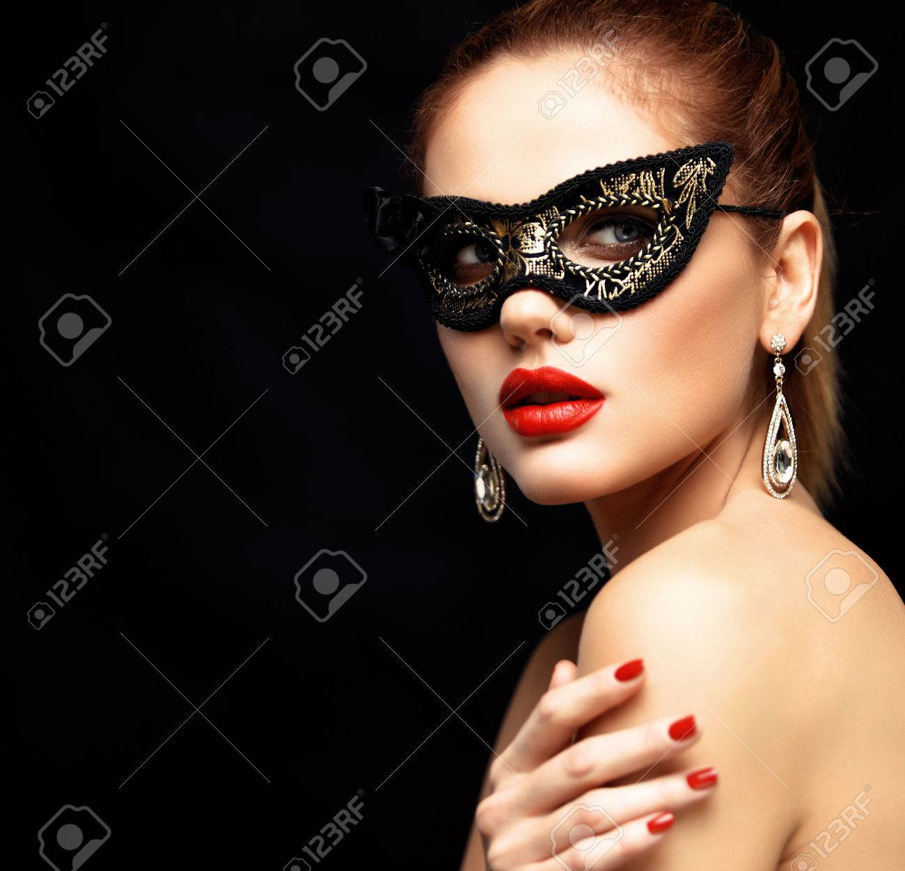 8f91fef2881d Beauty model woman wearing venetian masquerade carnival mask at party  isolated on black background. Christmas