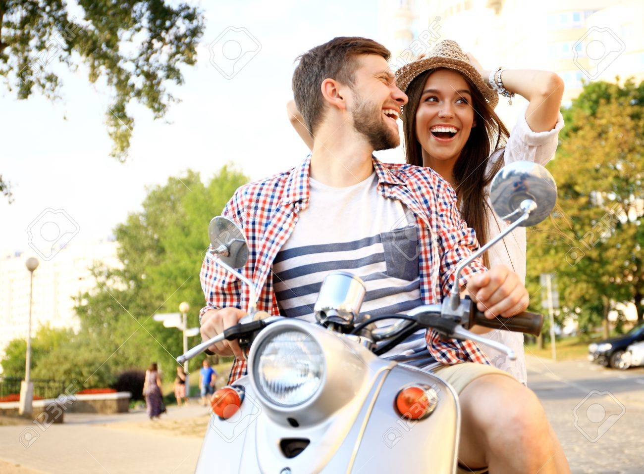 Couple in love riding a motorbike - 53536911