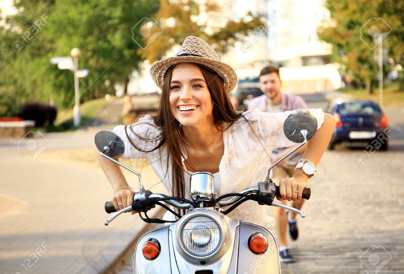 Handsome guy and young woman ride motorcycles Stock Photo - 53536938