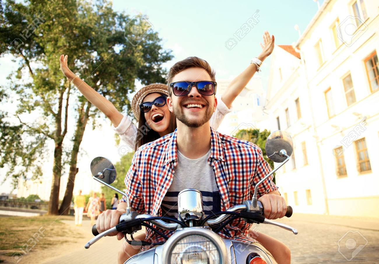 Couple in love riding a motorbike - 53536992