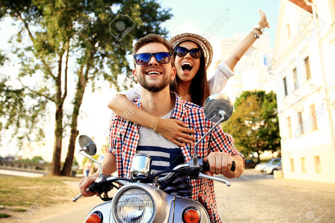 Couple in love riding a motorbike Stock Photo - 53536689