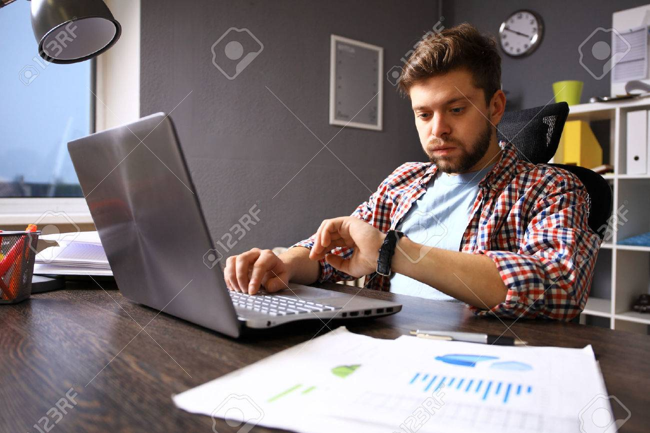 Business and time management concept. Stressed business man looking at wrist watch. Worried face expression. Human emotion - 53536398