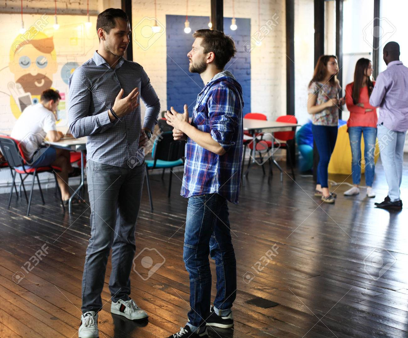 group of young business people , Startup entrepreneurs working on their venture in coworking space - 61316965