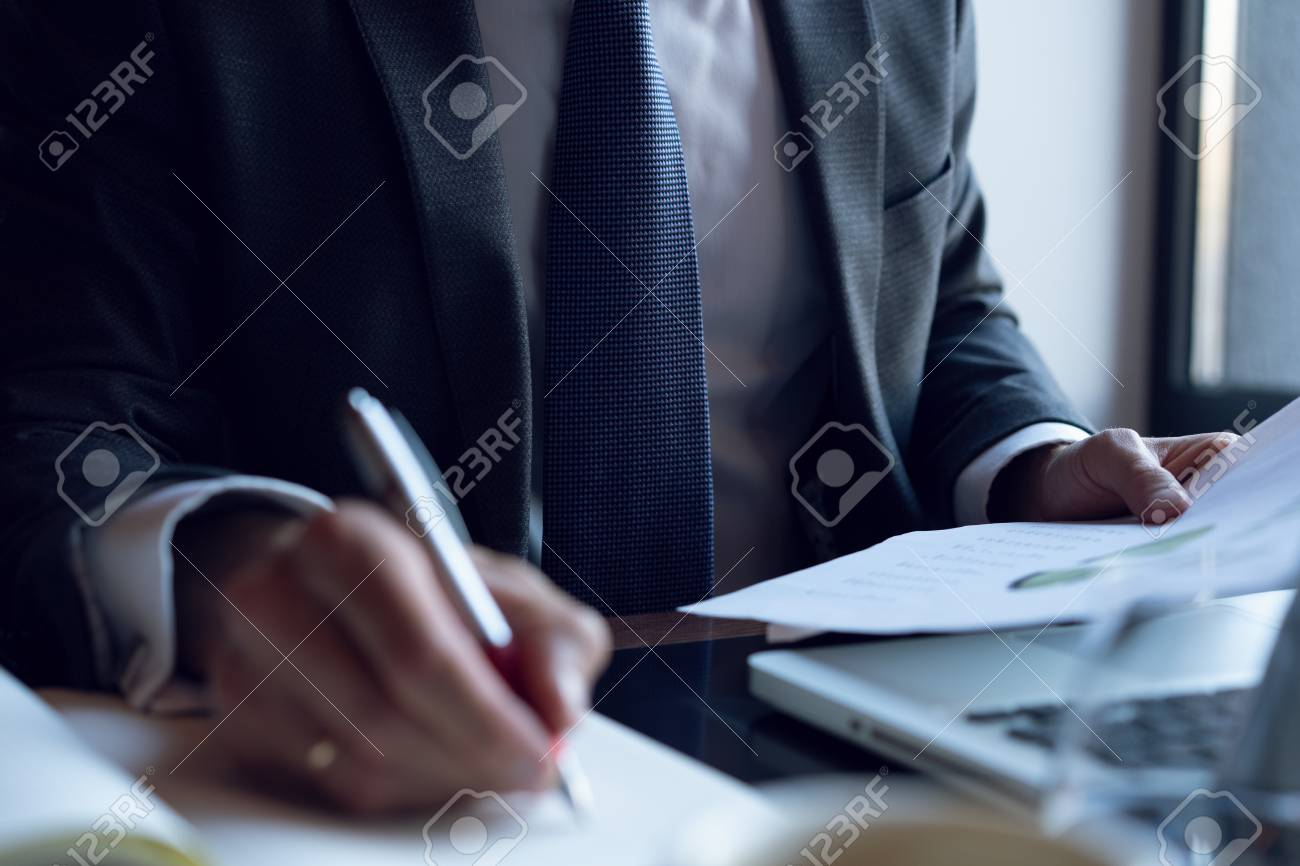 Businessman analyzing investment charts. Accounting. Hands of financial manager taking notes while working. - 113386289
