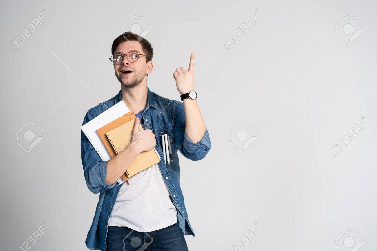 I have got brilliant idea. Caucasian cheerful man, raises index finger, has intriguing plan isolated over white background with copy space - 117961504