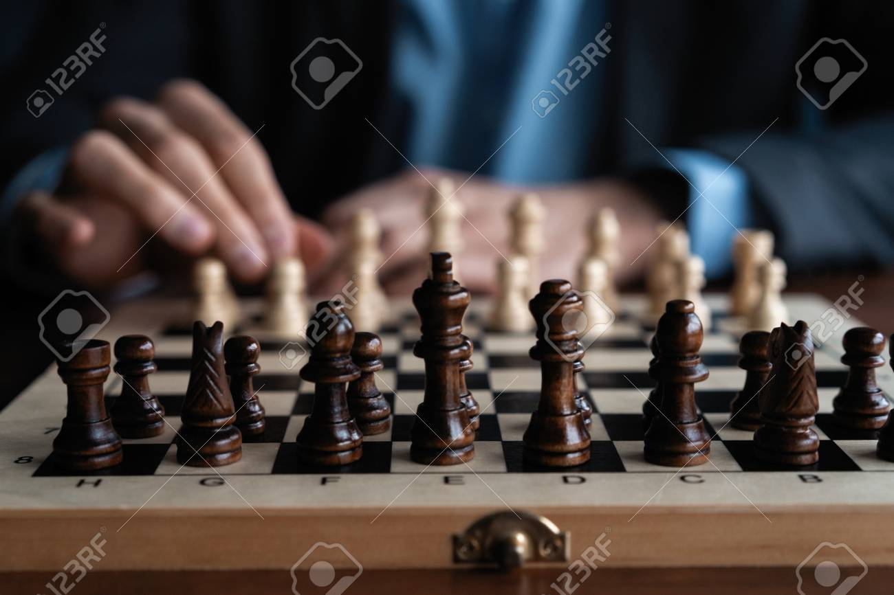 Businessman play with chess game. concept of business strategy and tactic. - 119770109