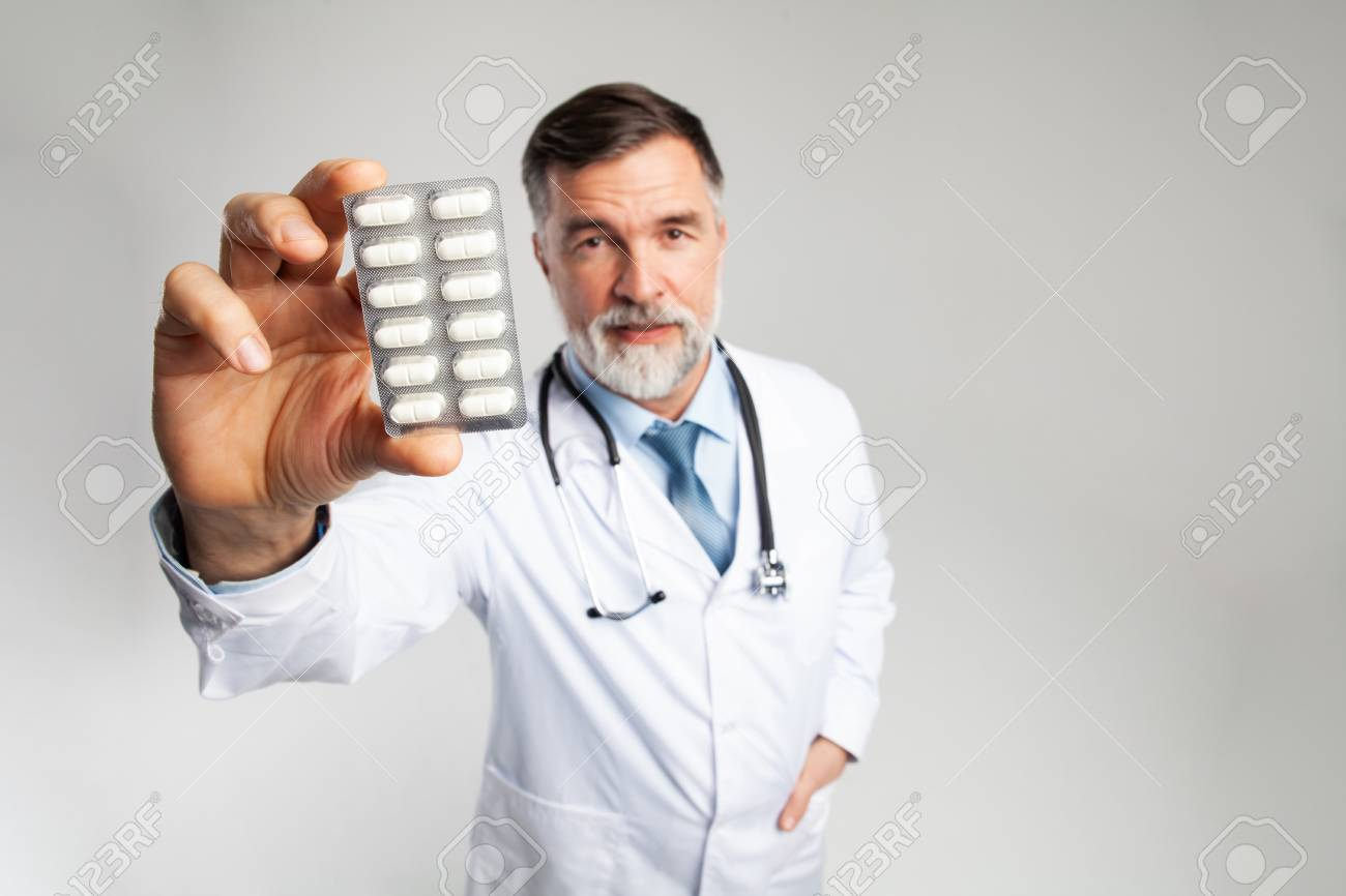 healthcare and medical concept - doctor with pill in hospital - 121958914