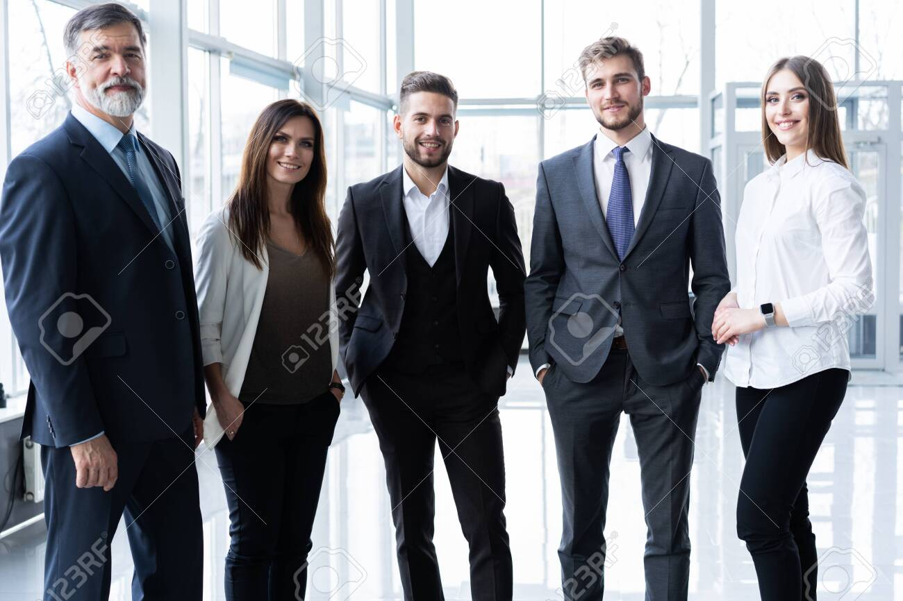 Full length confident business team stands in office. - 122628146